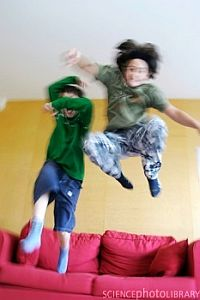 Hyperactive children bouncing on the sofa
